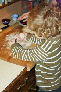 Here three year old LM has his first ball of bread dough to play with.